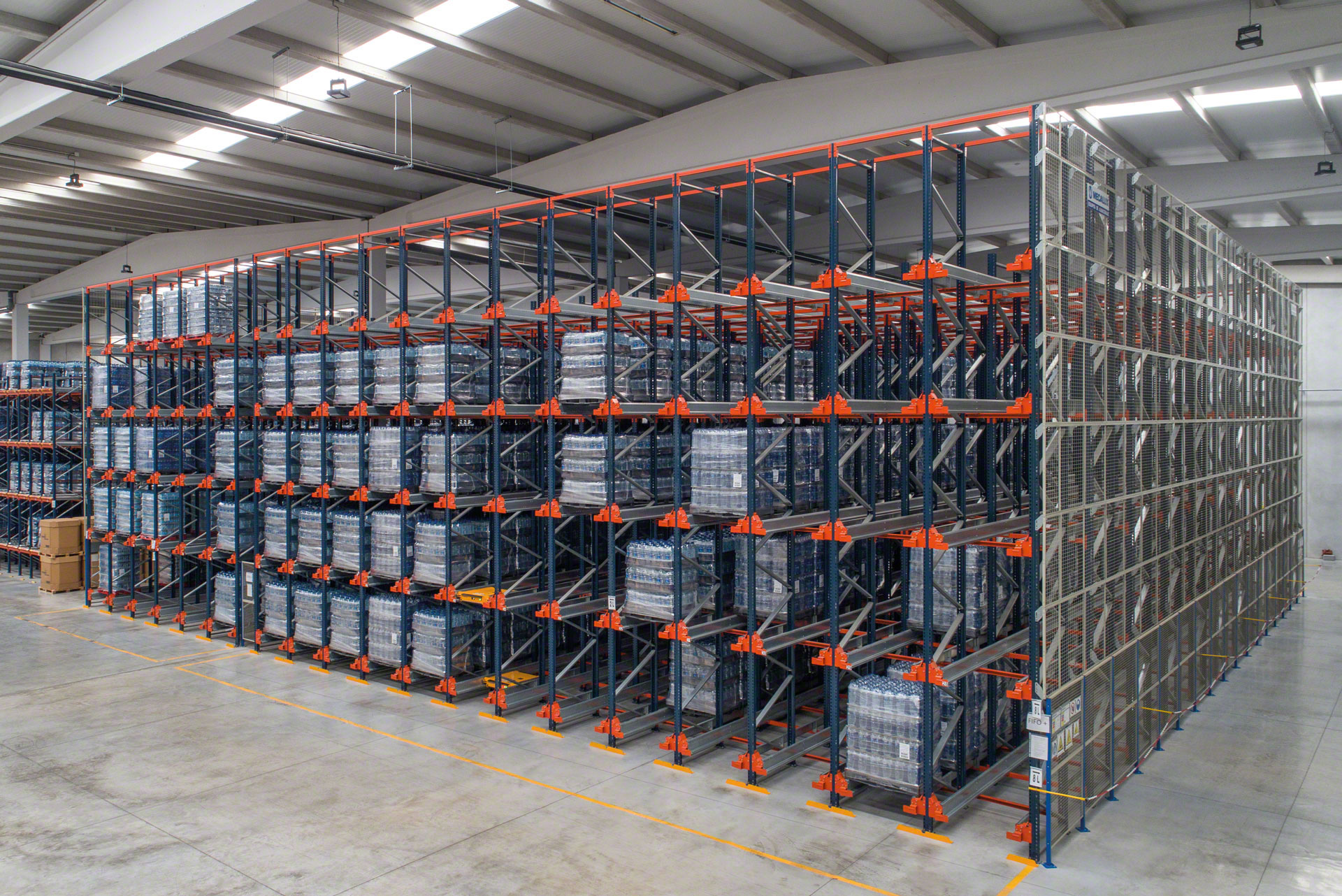 Handling equipment places the Pallet Shuttle in the storage channels